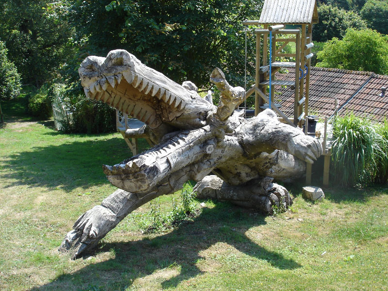 Carved tree trunk crocodile