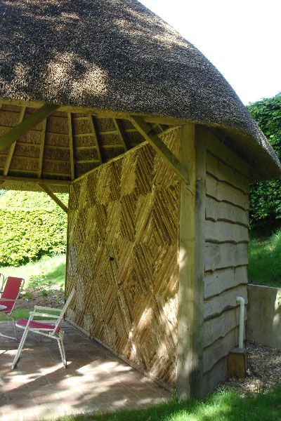Oak thatched summer house storage room