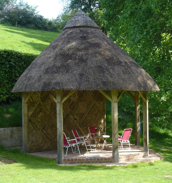 Oak thatched summer house